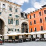 Tables outdoor restaurant on the Piazza della Signoria in Verona, Italy