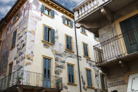 Photo for The picturesque house with murals on the street via Arche Scaligere in Verona, Italy - Royalty Free Image