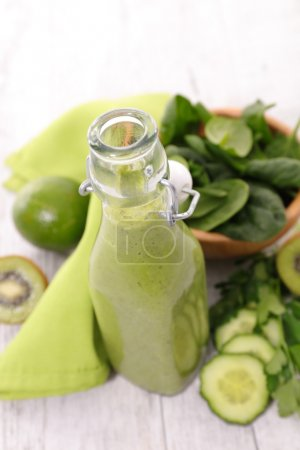 Photo for Green smoothie with fruits and vegetables in bottle - Royalty Free Image