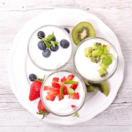 yogurt and fruits in glasses