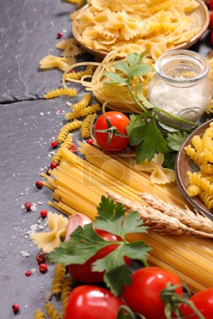 Photo for Raw pasta with ingredients assortment on table - Royalty Free Image