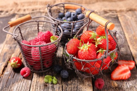 Photo for Fresh assorted berries, strawberries, raspberries, blueberries - Royalty Free Image