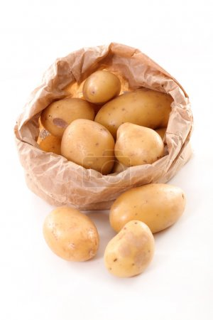 Photo for Raw potatoes in paper bag isolated on white - Royalty Free Image