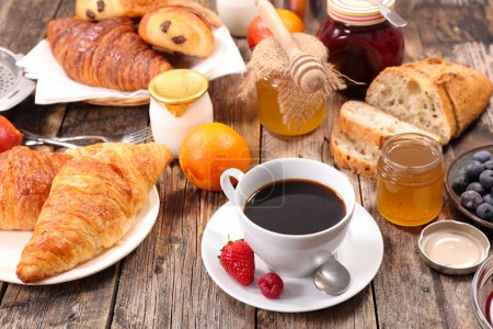 Photo for Breakfast with coffee, jam, juice, fruits and croissants - Royalty Free Image