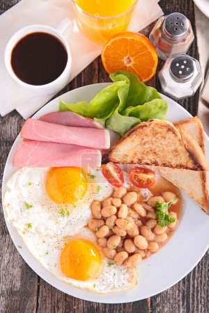 Photo for Tasty English breakfast with toasts, eggs, coffee, juice and vegetables - Royalty Free Image