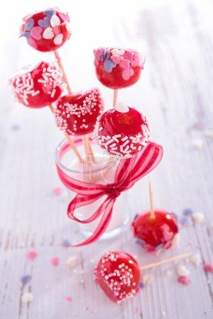 Tasty lollipops in glass