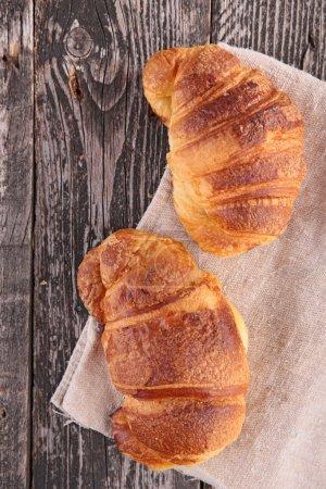 Fresh croissants on wood