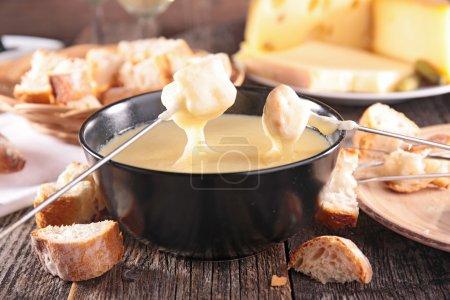 Tasty cheese fondue close up