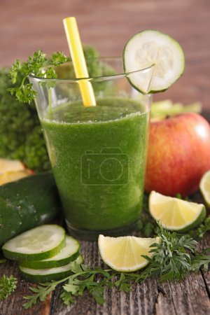 Photo for Organic green fresh cocktail with fresh vegetables and fruits near - Royalty Free Image