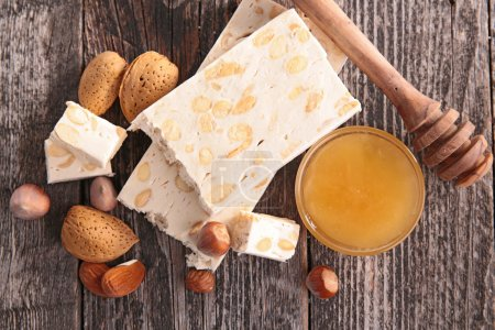 Photo for Nougat dessert with nuts and honey top view on table - Royalty Free Image
