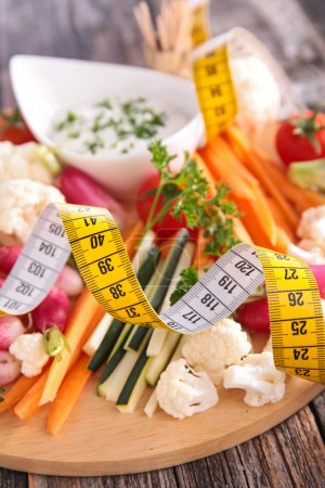 Photo for Salad and sauce with tape meter. healthy diet concept - Royalty Free Image