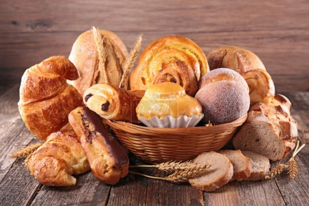 Photo for Croissant and various bread, bakery on wooden table - Royalty Free Image