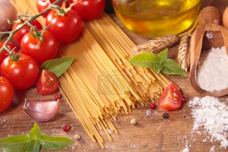 Photo for Raw spaghetti and ingredients. italian food. close up on table - Royalty Free Image