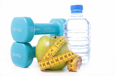 apple, dumbbells, tape measure