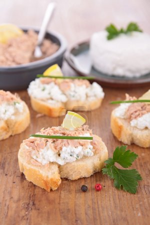 Photo for Canape with rillette and cheese with ingredients on table - Royalty Free Image