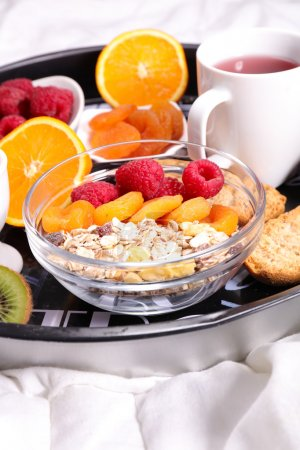 Photo for Traditional healthy breakfast with muesli, fruits, juice, bread, egg, tea - Royalty Free Image