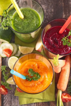 Photo for Vegetable juices collection in glasses top view on table - Royalty Free Image