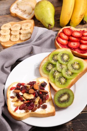 Photo for Breakfast toasts with fruits. healthy diet food - Royalty Free Image