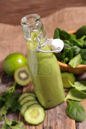 Photo for Healthy green smoothie with kiwi, cucumber and spinach - Royalty Free Image