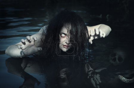 Terrible dead ghost woman in the water outdoor...