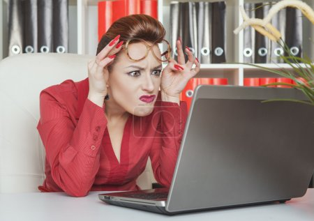 Photo for Crazy business woman in glasses working with laptop - Royalty Free Image