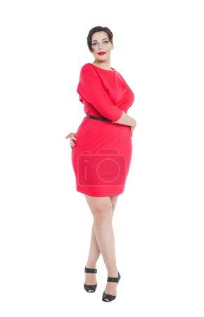 Beautiful plus size woman in red dress posing