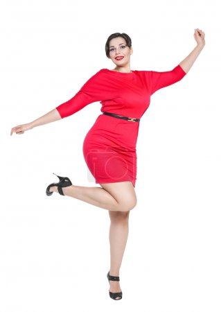 Happy beautiful plus size woman in red dress with hands up