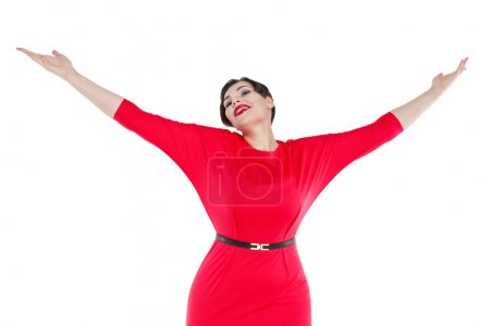 Happy beautiful plus size woman in red dress with hands up isola