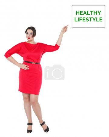 Beautiful plus size woman in red dress showing on healthy lifest