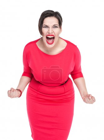 Angry screaming beautiful plus size woman in red dress isolated