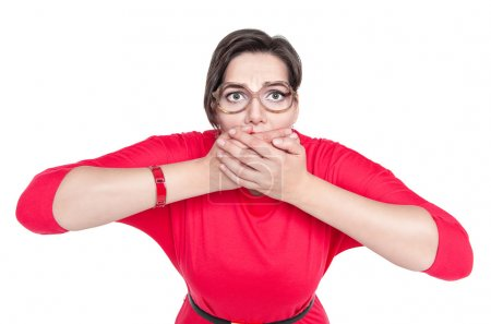 Beautiful plus size woman in glasses covering her mouth with han