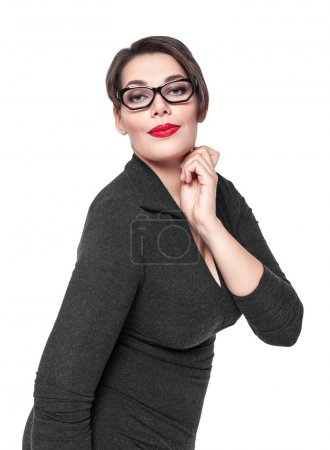 Beautiful plus size woman in black dress and glasses posing isol
