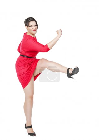 Photo for Beautiful plus size woman fighting off something isolated on white background - Royalty Free Image