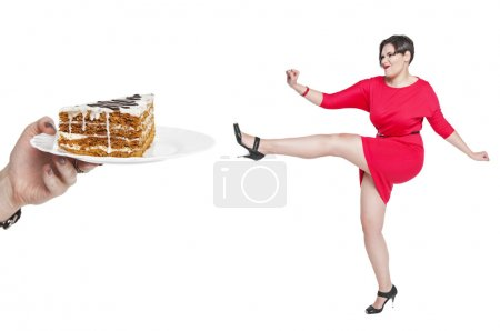 Photo for Beautiful plus size woman fighting off unhealthy food isolated on white background - Royalty Free Image