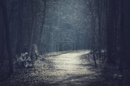 Halloween landscape. Dark forest with empty road
