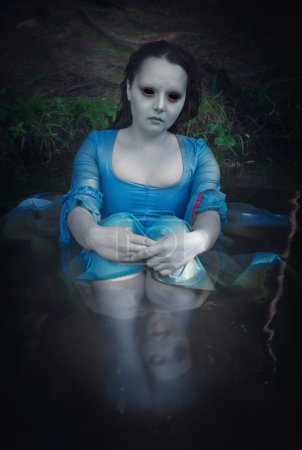 Terrible dead ghost woman sitting in the water...