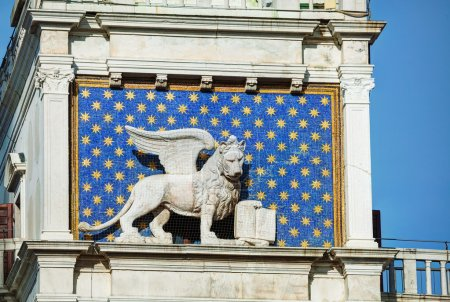 Winged lion on facade of bell tower