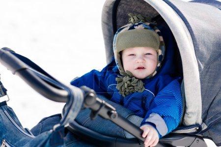 Cute little baby in a stroller outdoor