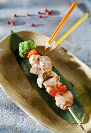 Chicken skewers and vegetable dipping sauce.