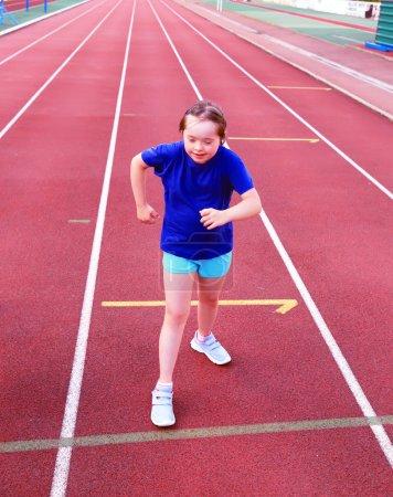 Little girl have fun on the stadium...