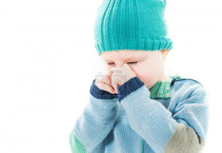 Photo for Little crying boy in hat and sweater portrait on a white background - Royalty Free Image