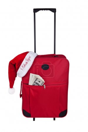 The tourist suitcase with dollars and cap of Santa Claus