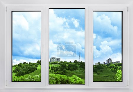 Modern plastic window with a view of the sky, nature and city