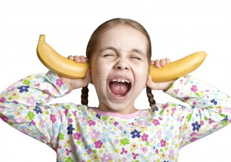 The child cries covered his ears with bananas...