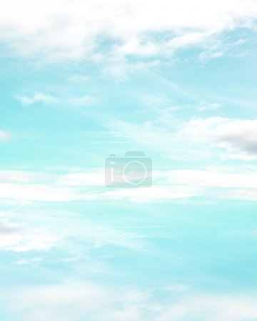 Photo for Sunny bright blue and green colored sky with white puffy clouds. - Royalty Free Image