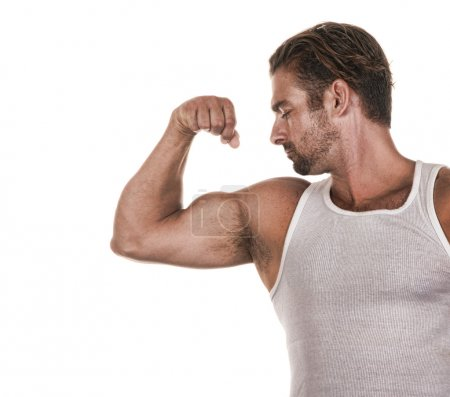 Photo for Nice powerful Image of a man showing Bicep - Royalty Free Image
