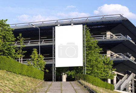 Photo for Vertical blank billboard in front of car parking facility - Royalty Free Image