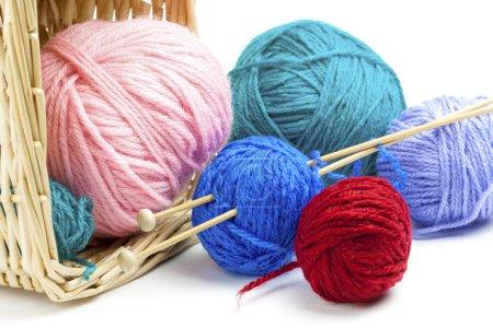 Colorful yarn balls falling on white background