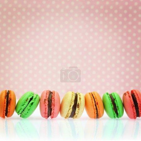 Photo for Traditional french colorful macaroons on retro background - Royalty Free Image