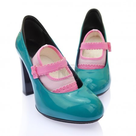 Baby shoes on mom's high heels